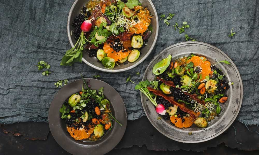 Warm Pan-fried Brussels Sprouts, ClemenGold and Black Rice Salad with Crispy Bacon & Almonds via @crushonlinemag