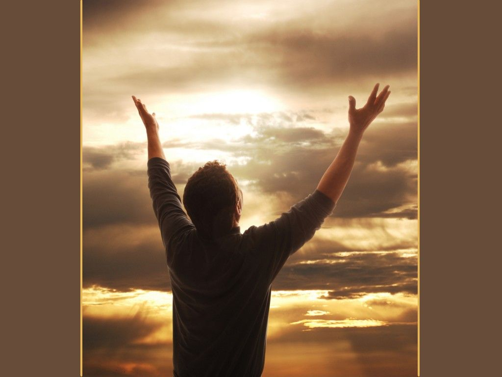 images of christian worship | ... holding arms up in praise against golden sunset - Christian Wallpaper