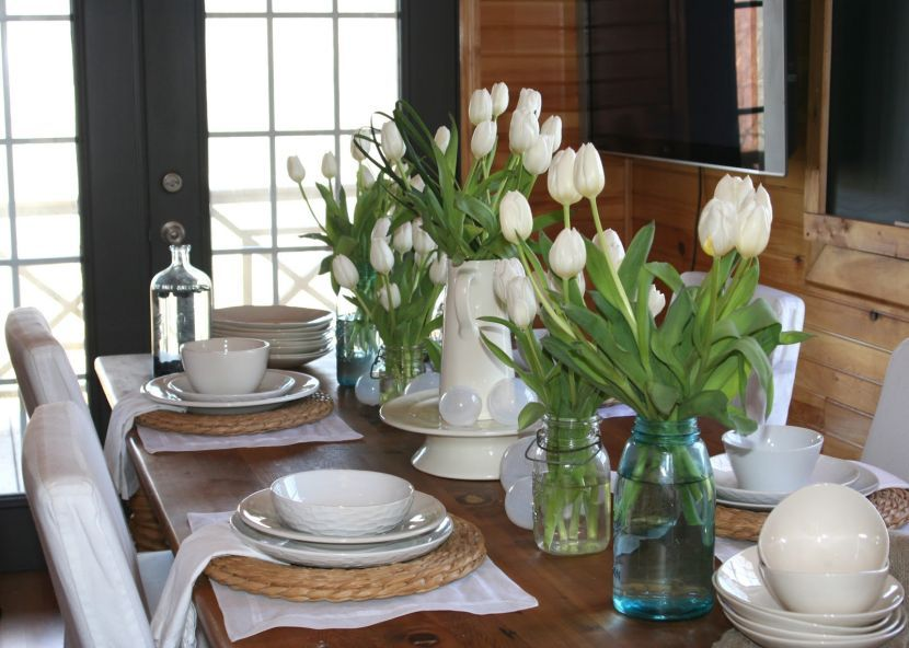 White Vase And Transparent Bottles With Flowers As Dining Table CenterpiecesCentrepiecesDining TablesHome DecorFlower
