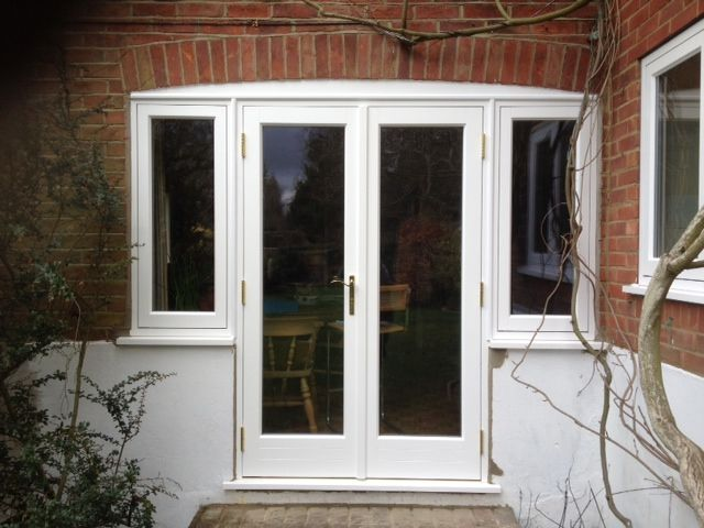 Timber French doors with side windows