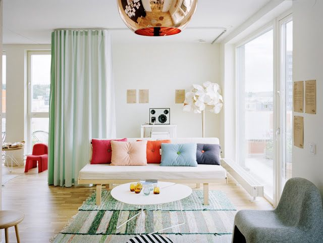 Two toned curtains.  Ceiling mounted drapes.  Mint green ombre look. White living room. Copper pendant light. http://cococozy.com