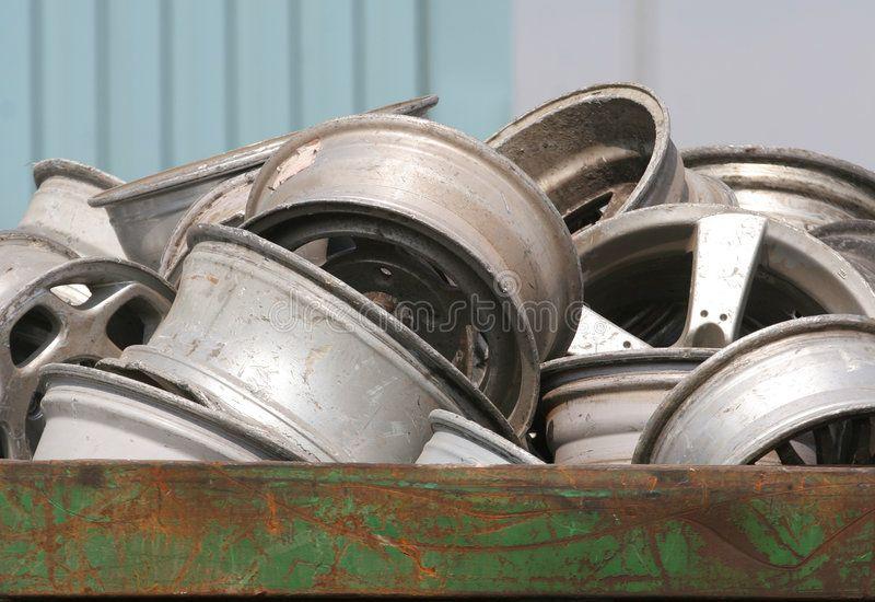 Scrap Wheels. Metal bin full of alloy wheels for recycling