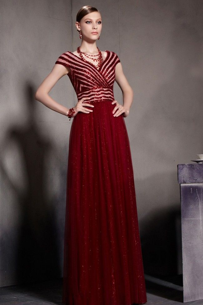 Here is an elegant red evening gown that was inspired by a celebrity ...