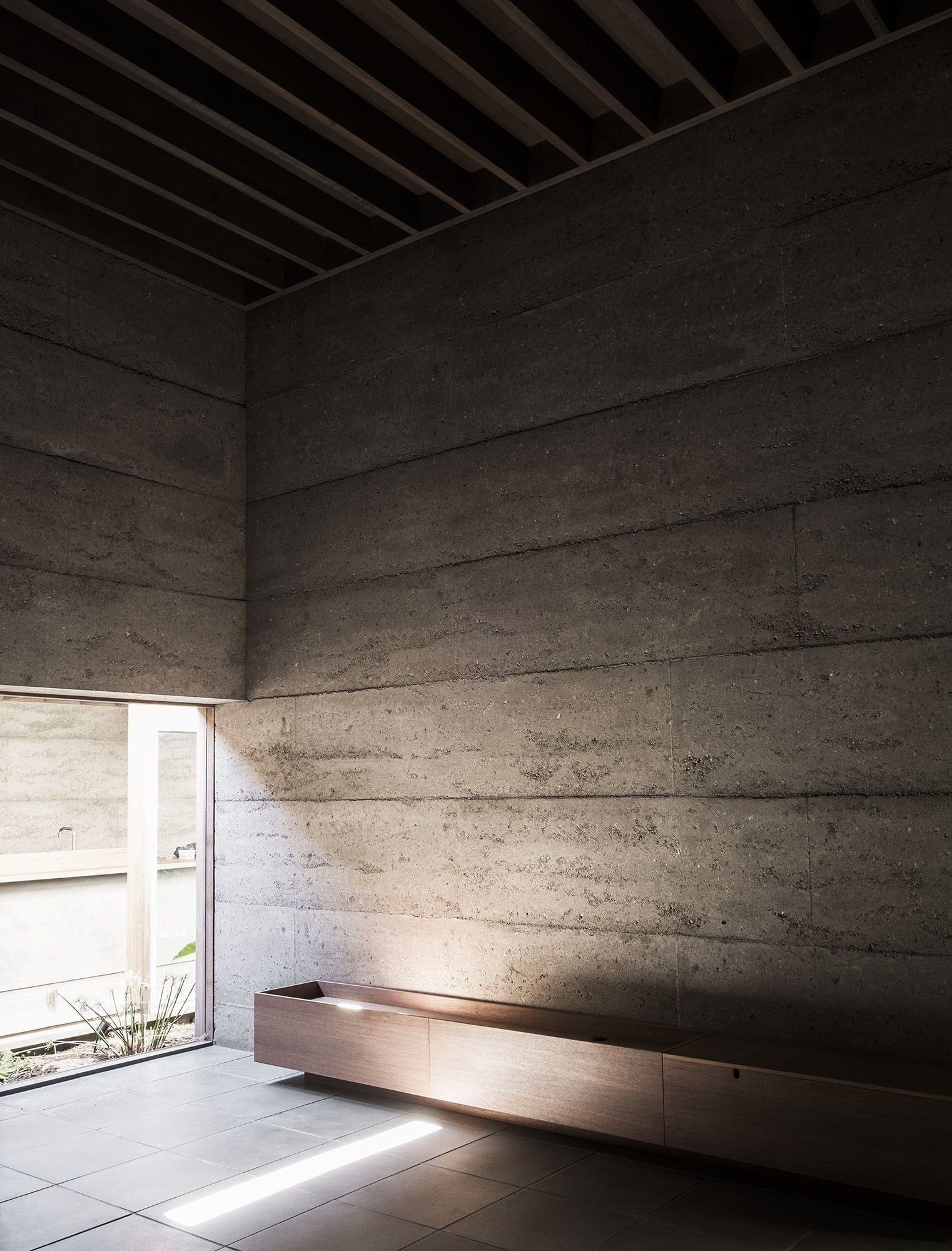 Rammed Concrete Walls Are Unadorned With Further Embellishment Concrete Wall Architecture Australian Architecture