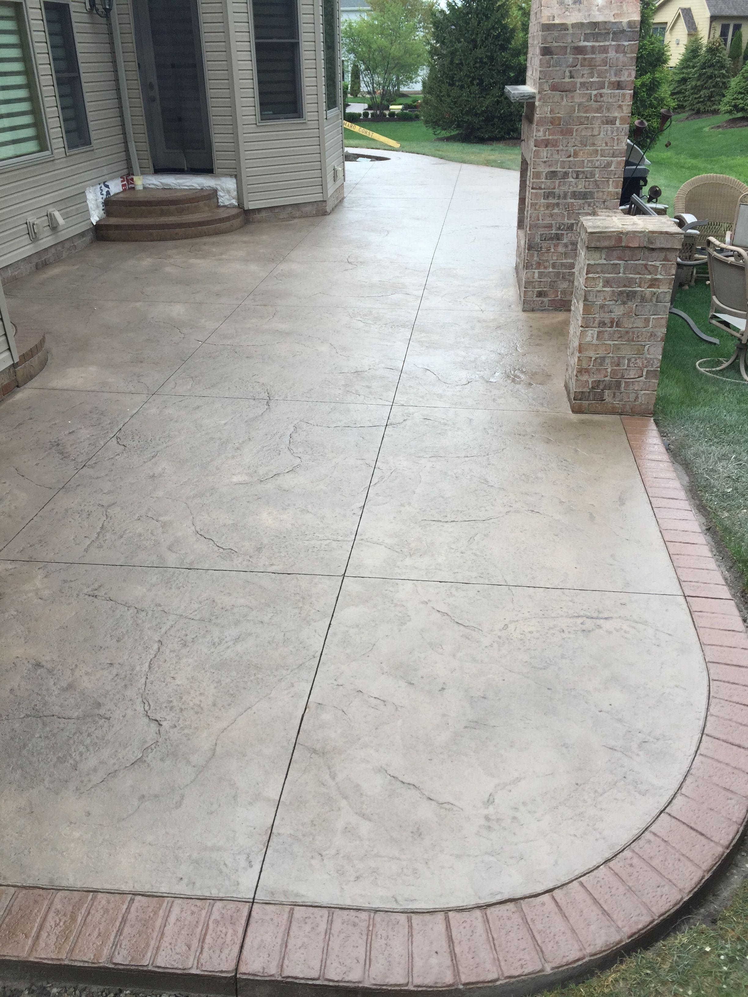 Stamped patio w 2 sets of landingssteps w matching brick borders  facing on landingssteps