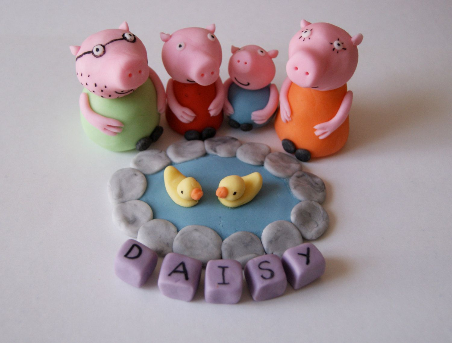 Handmade peppa pig pond and figures cake by rosiemag114 on