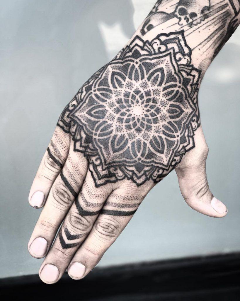 Black Ornamental Mandala Tattoo On The Right Hand Hand Tattoos For Guys Mandala Hand Tattoos Tattoos