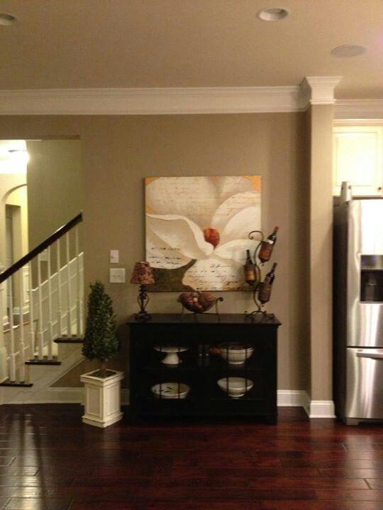 Wood floors, crown molding, wall color, stairway