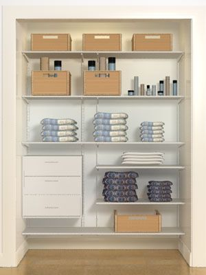 Organized linen closet with drawers