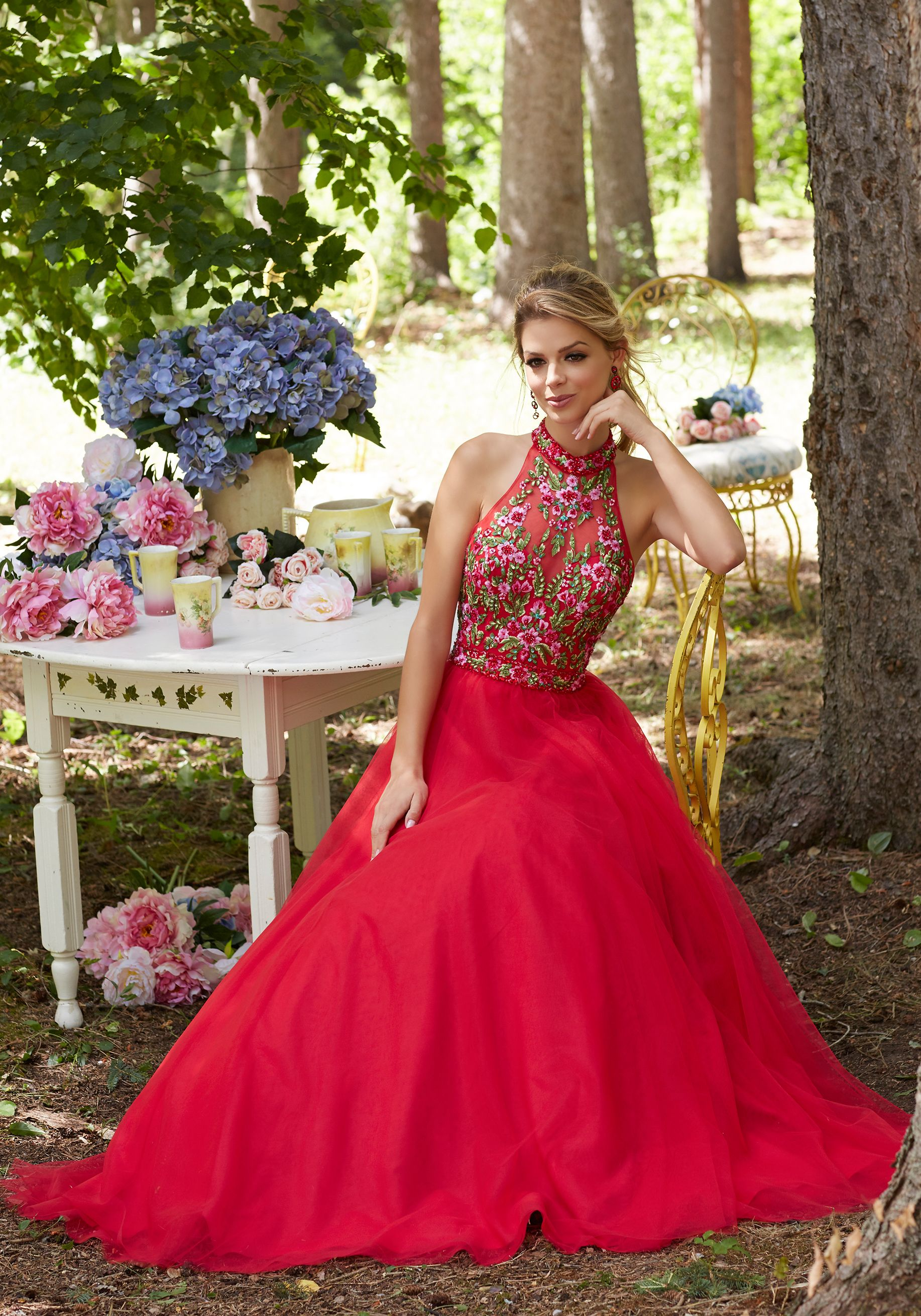 Soft tulle prom gown with floral embroidered bodice and open keyhole