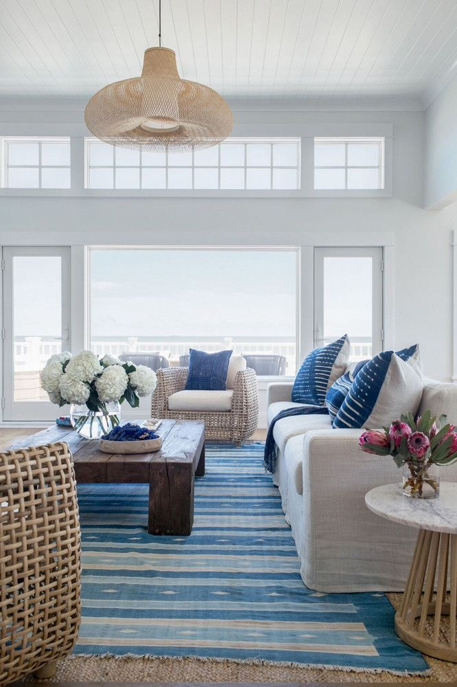 This Seaside House Is Giving Us So Many Beachy Decor Ideas Domino Blue And White Living Room Coastal Living Rooms Beach House Interior