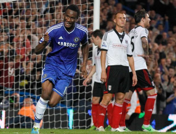 Chelsea's Mikel, left celebrates after scoring a goal against Fulham during the English Premier League soccer match between Chelsea and Fulh...