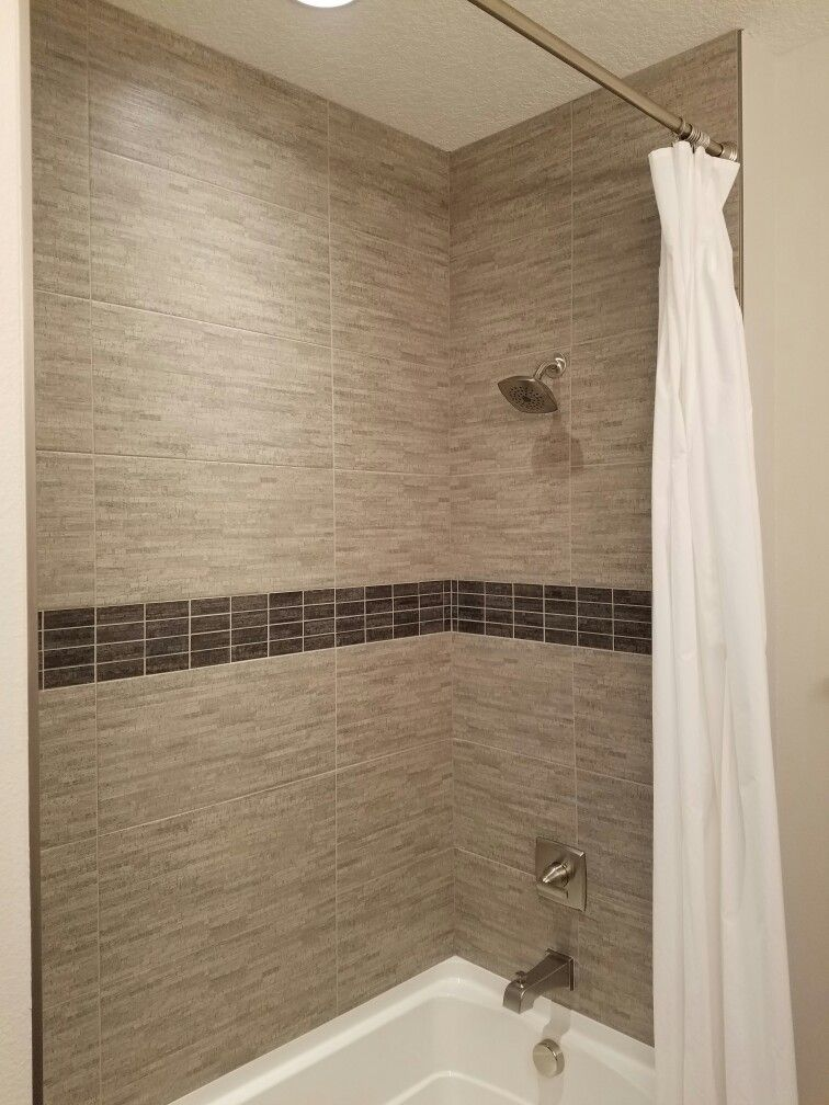 Kids shower/tub. Tall tub. Shower tile all the way up to the ceiling ...