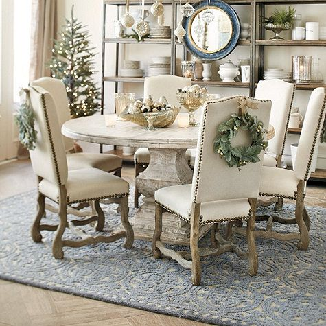 Round Table And Upholstered Dining Chairs Dining Room Decor