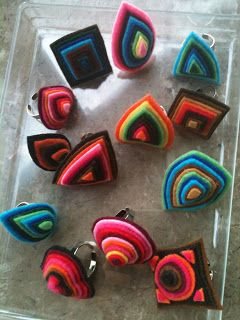 Felt rings - Site is in Portuguese and doesn't have a tutorial, but they look fairly easy to make. :)
