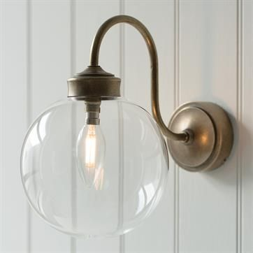 Compton bathroom outdoor wall light in antiqued brass made by jim lawrence