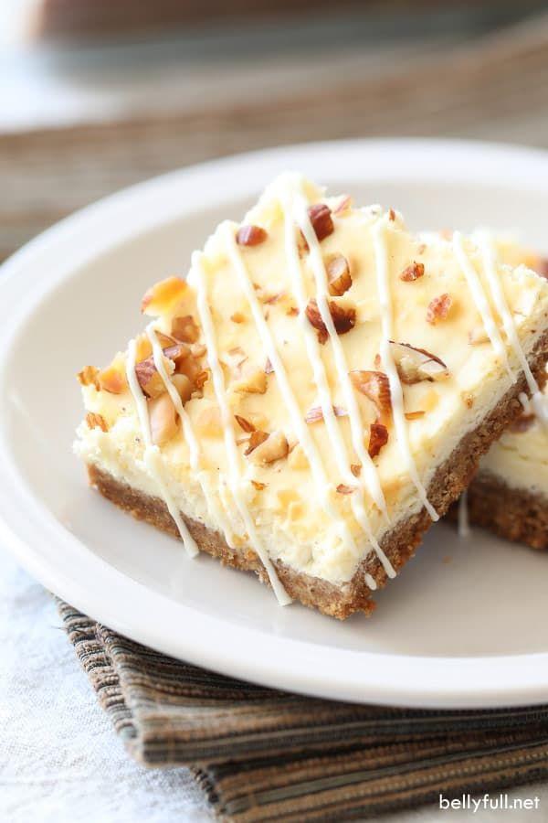 Eggnog Cheesecake Bars with White Chocolate Drizzle #eggnogcheesecake