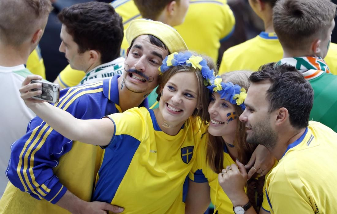 Sweden fans take a photograph before the match