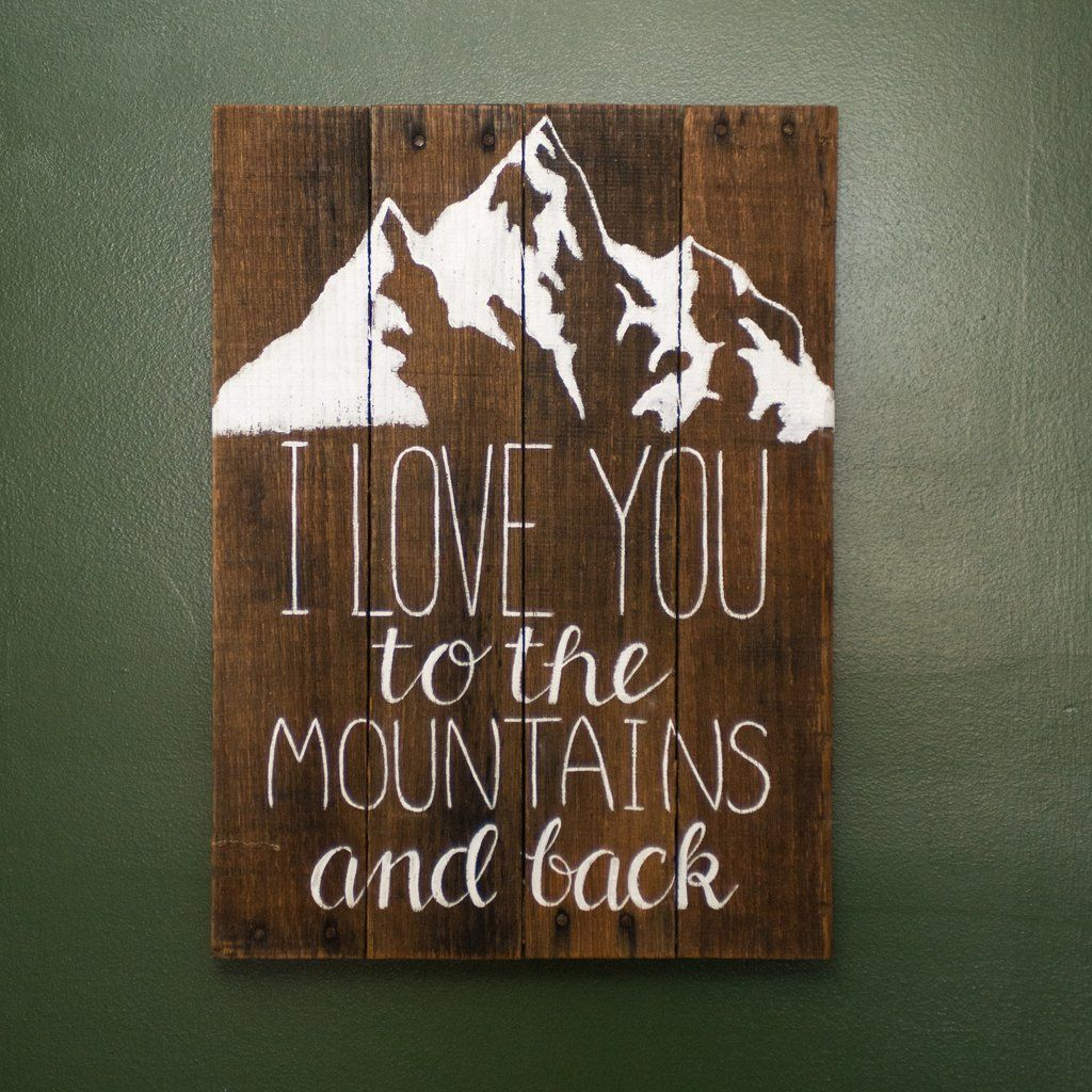 """• Handcrafted and painted by North Carolina artisans• Created with naturally distressed, reclaimed wood• Provides a rustic accent for any room in your home• Dimensions: 14"""" x 20""""*This item is made to order. Variations in color and the number of boards used may occur depending on the wood available. """"I love you to the mountains and back""""Share your love for your special someone and the beautiful mountain landscapes with this handmade sign!The wooden canvas is constructed wit..."""