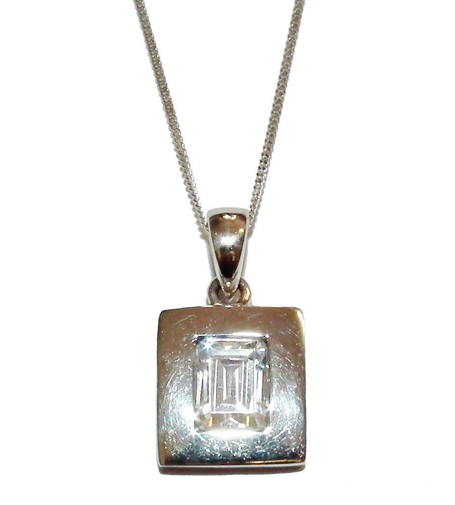 Stamped sterling silver u clear gem set oblong pendant u