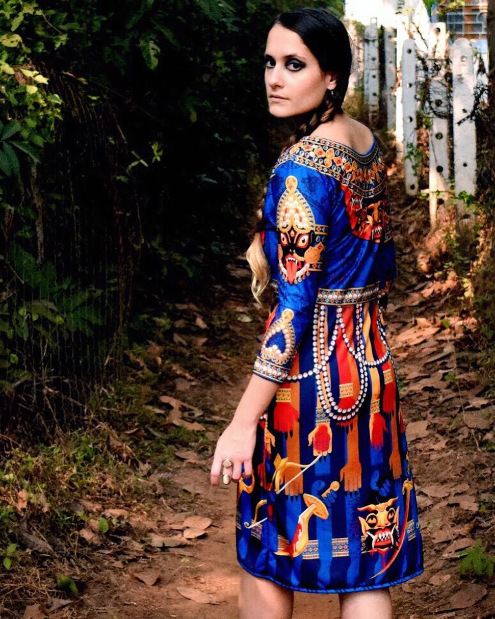 The kali dress the illustrations on this garment sprout from the