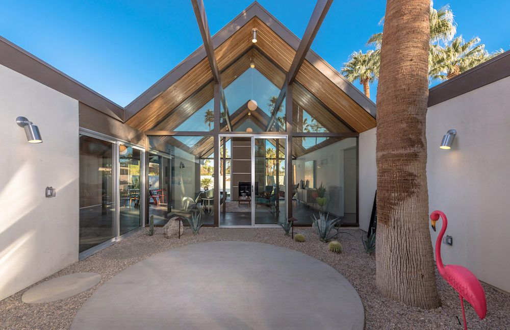 New eichler in palm springs asking 129m boasts spa pool a home built with the desert eichler 2 blueprint has circular concrete patio spaces gravel modern gable roofing and walls of glass malvernweather Choice Image
