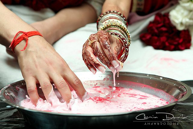 Wedding Game The Groom S Mom Throws A Ring And Other Small Items In A Bowl Of Milk And The Ne Indian Wedding Games Gujarati Wedding Indian Wedding Photography