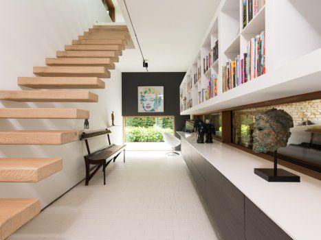 Zwevende trap met houten treden trapstructuur eigen ontwerp