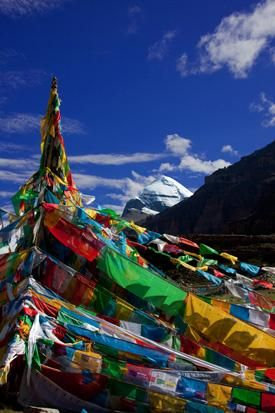 Mount Kailash in Western Tibet with prayer flags in the foreground.