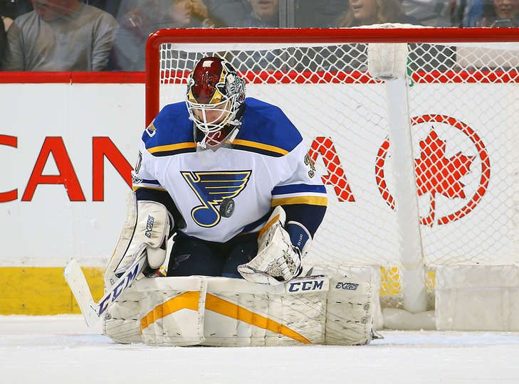 Winnipeg Mb January 21 Goaltender Pheonix Copley 30 Of The St Louis Blues Makes A Save During First Period Action Against Hockey Goalie Goalie Pads Blues
