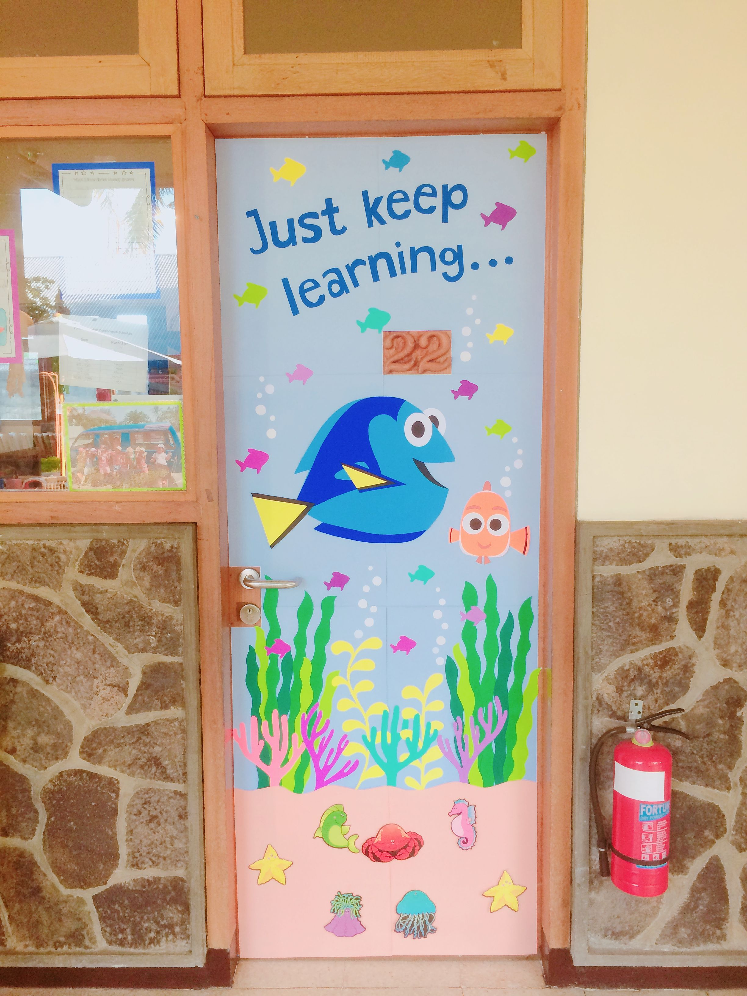 "Under the Sea themed door display: ""Just keep learning ..."