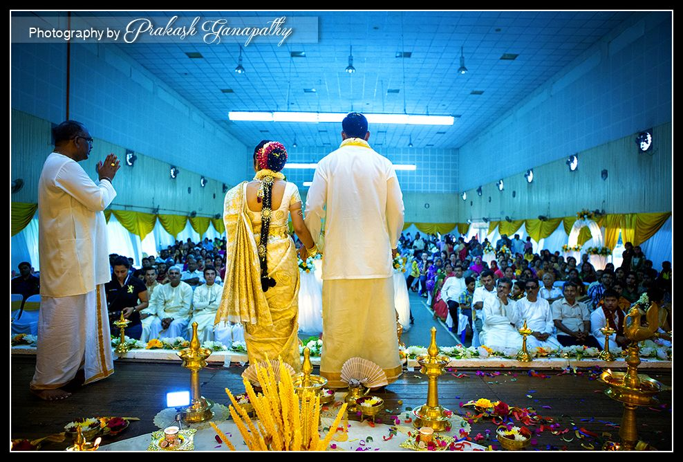 the couple asking for blessing from the crowd during the ceremony