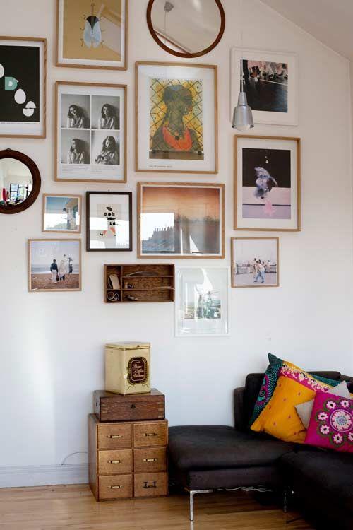 photo / art / print / mirror wall display and colorful pillows on a basic sofa