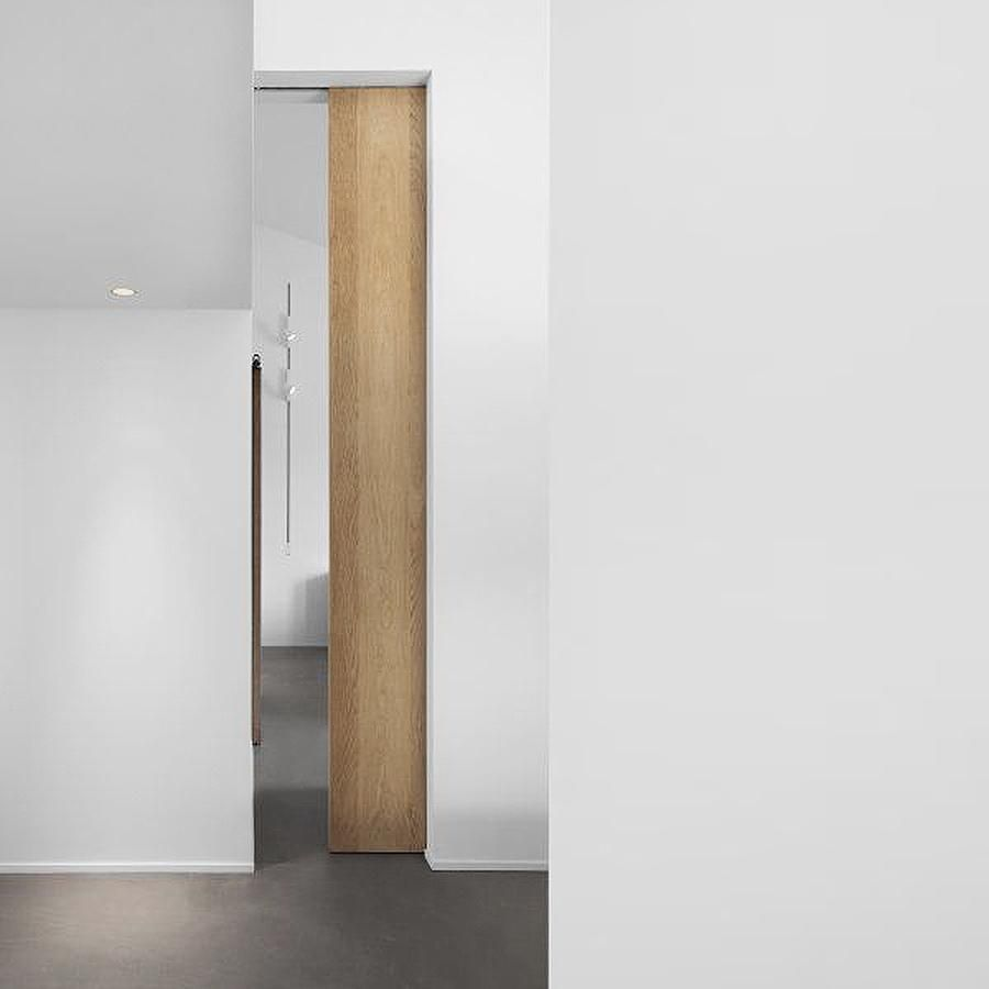 These wooden sliding doors are custom made for ceiling…