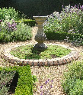Sundial As Focal Point Or Sundial Tucked Among The Flowers Can T