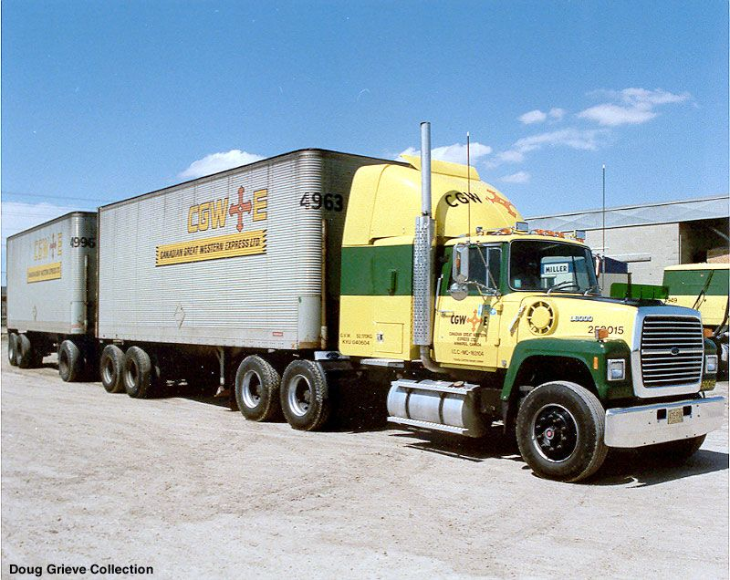 Canadian Great Western Express Ford L9000 with a set of vans