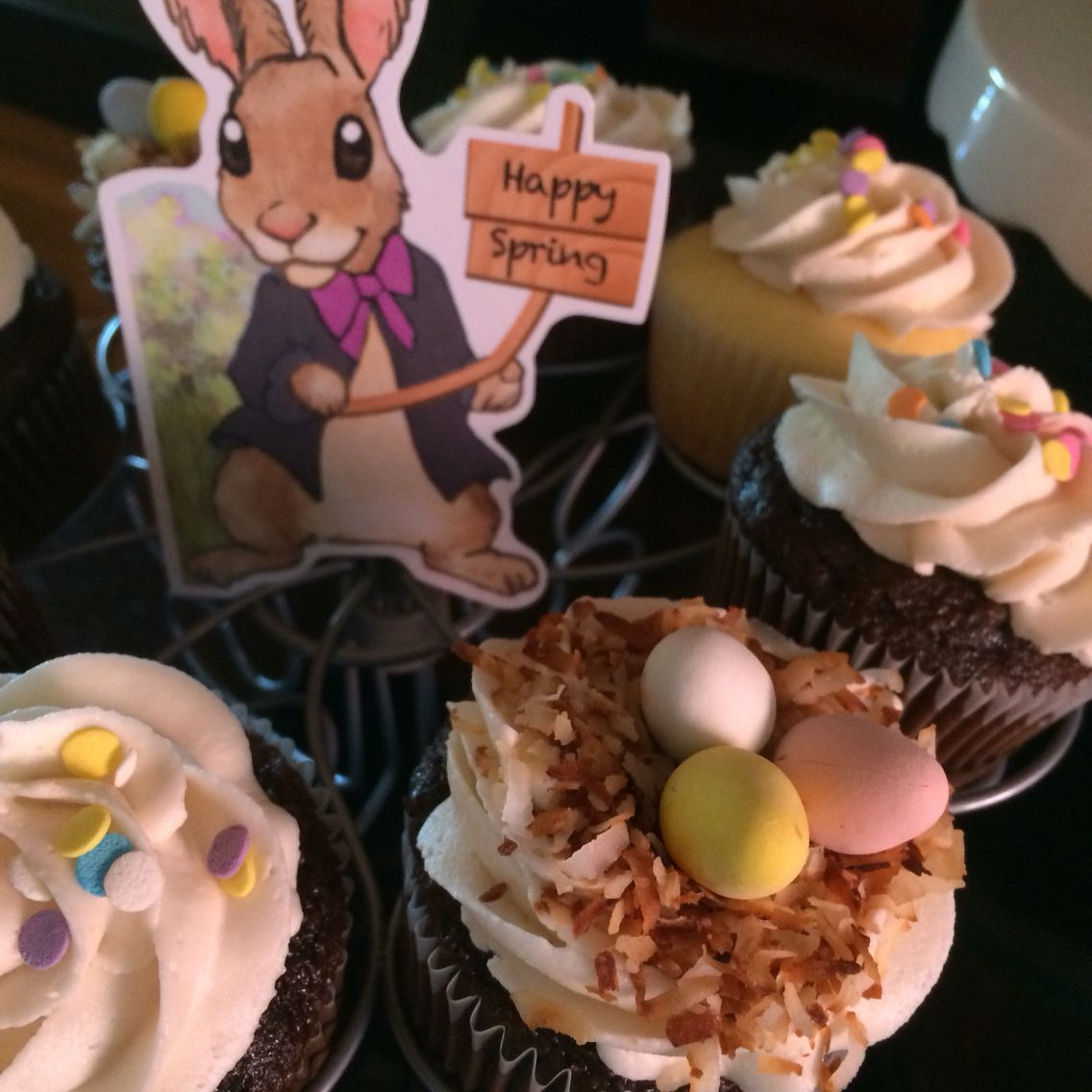 Easter / spring cupcake display. Simple cupcakes decorated with toasted coconut and Cadbury eggs.