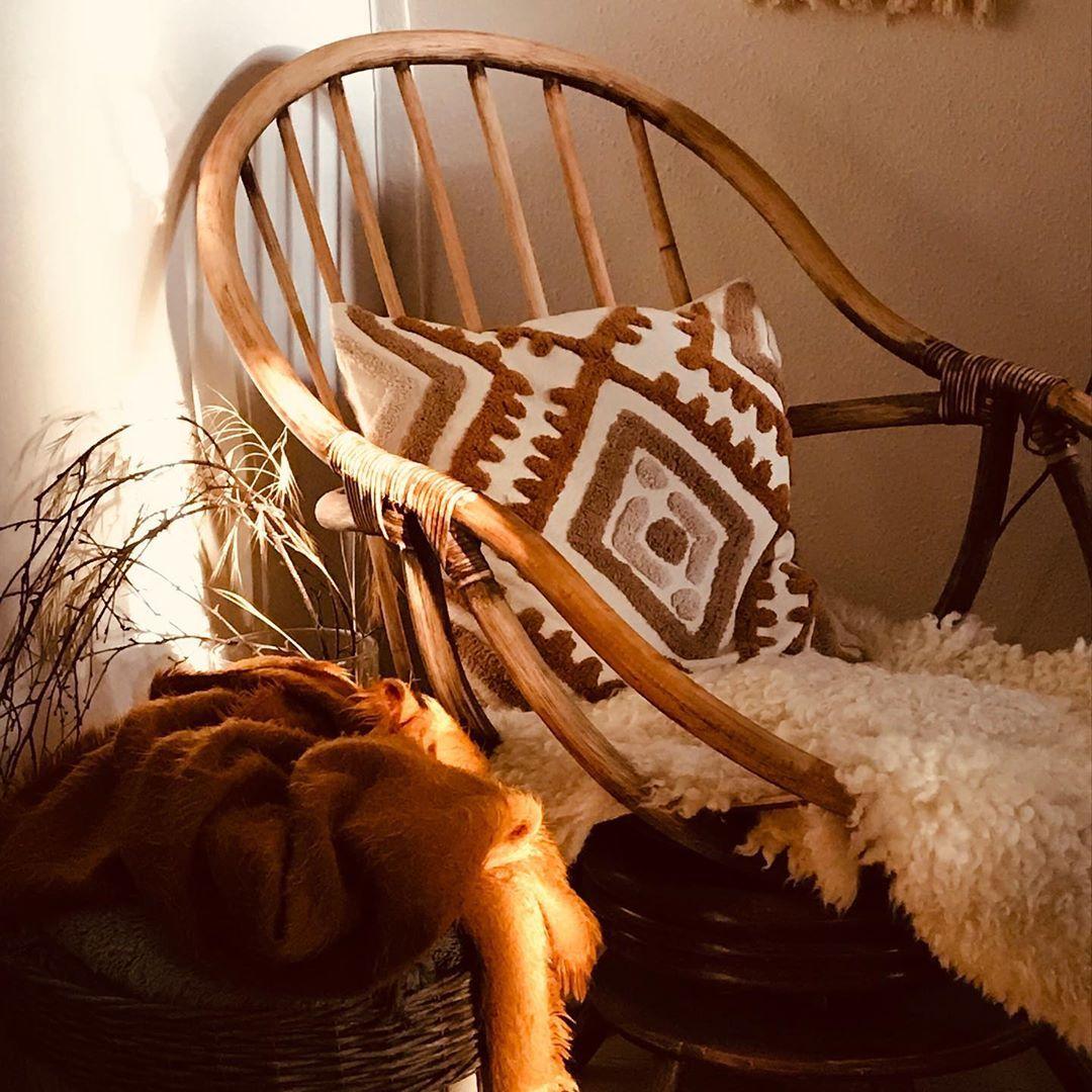 Boho reading nook rattan chair pillow textile faux fur