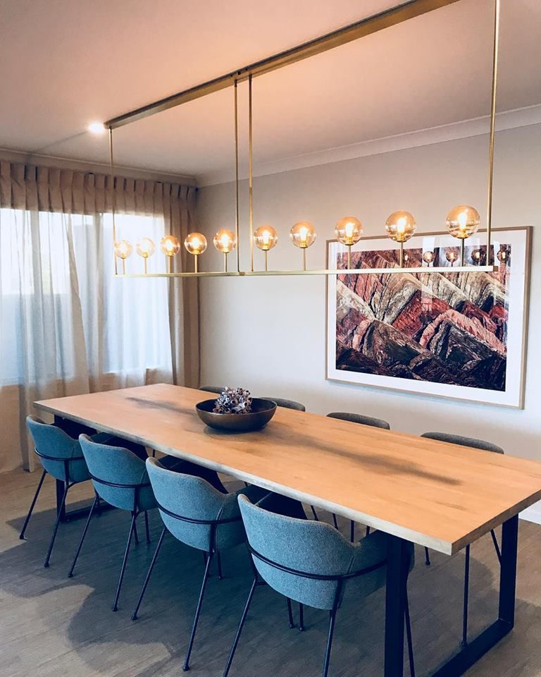 This dining area is the perfect place to dine with tasteful pendant lighting and a perfect view of the backyard. Built by the G.J. Gardner Homes team at Townsville.