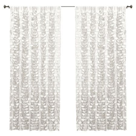 Add feminine-chic flair to your master suite or guest bedroom with this lovely tiered curtain, showcasing textured circular ruffles in white.