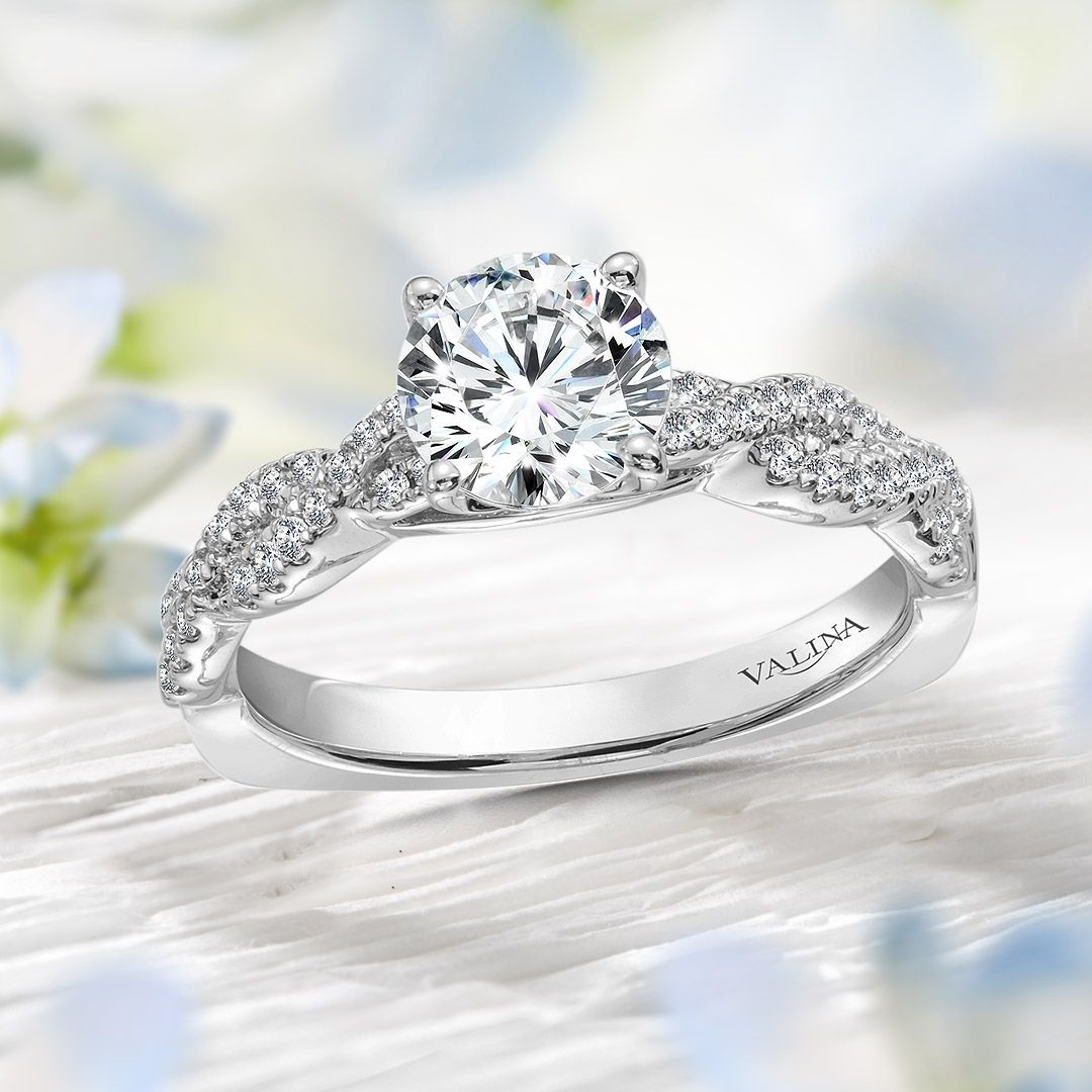 Diamond crisscross engagement ring mounting with side