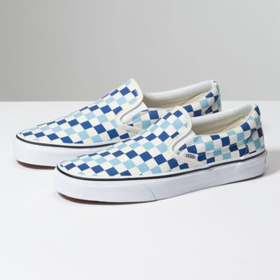 268bb2bfe5579e The Checkerboard Classic Slip-On features sturdy low profile slip-on canvas  uppers made with the iconic Vans checkerboard print