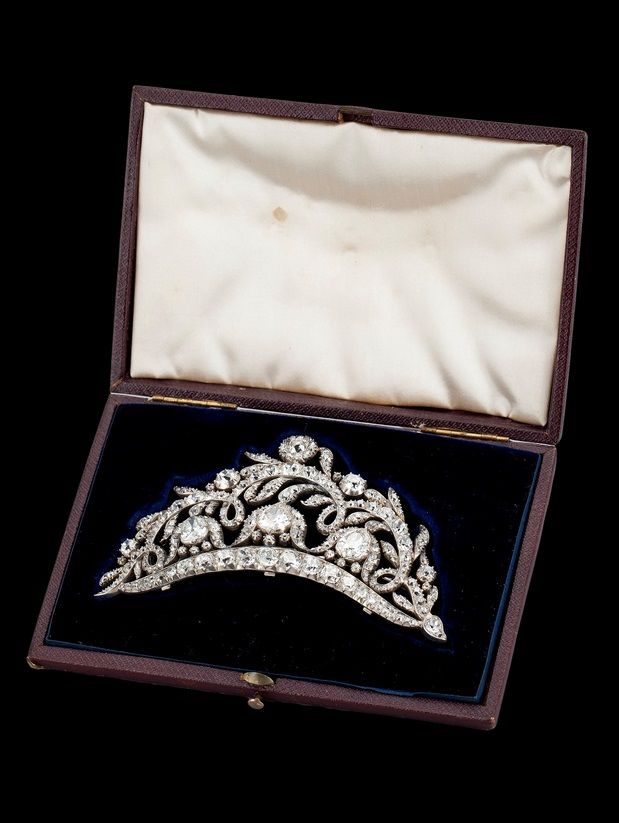 An antique diamond tiara / brooch. Mounted in silver, the drop shaped diamonds weighing approximately 1.70-2.00 cts, later brooch pin in gold, tiara stand and box. #antique #tiara #brooch