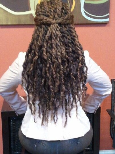 Havana twists. To learn how to grow your hair longer click here - http://blackhair.cc/1jSY2ux