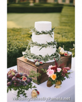 A pretty royal iced Wedding Cake dressed with olive branches and sprigs of fresh lavender was just perfect for this gorgeous Provencal Wedding. Presented on a wine crate with fresh fruit & flowers it looked as good as it tasted! Pamela designs and makes Wedding Cakes for destination weddings in the French Riviera, Provence, Var and Alpes Maritime. Delivering throughout the region from Monaco, Nice, Cannes, to Saint Tropez & Aix en Provence and everywhere in between.