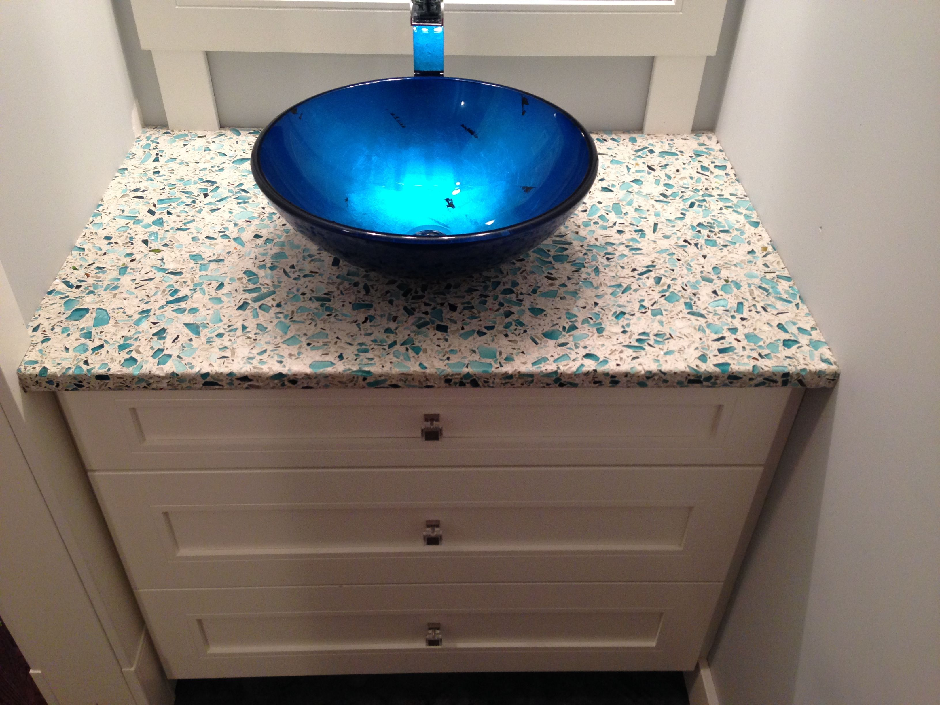 Beautiful Blue Vessel Sink With Blue Vetrazzo Counter Tops.