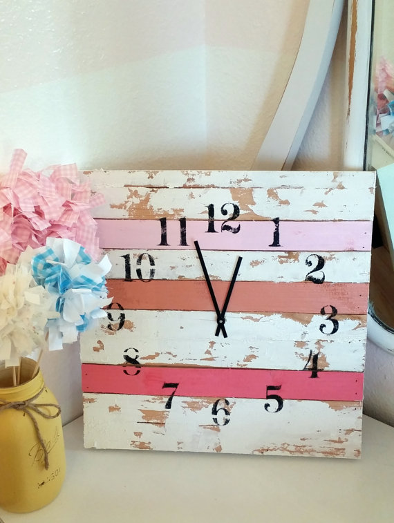 This is a handmade clock made out of recycled wood. I handpainted 3 slats 3 different color pinks and then did the rest of the wooden slats in a