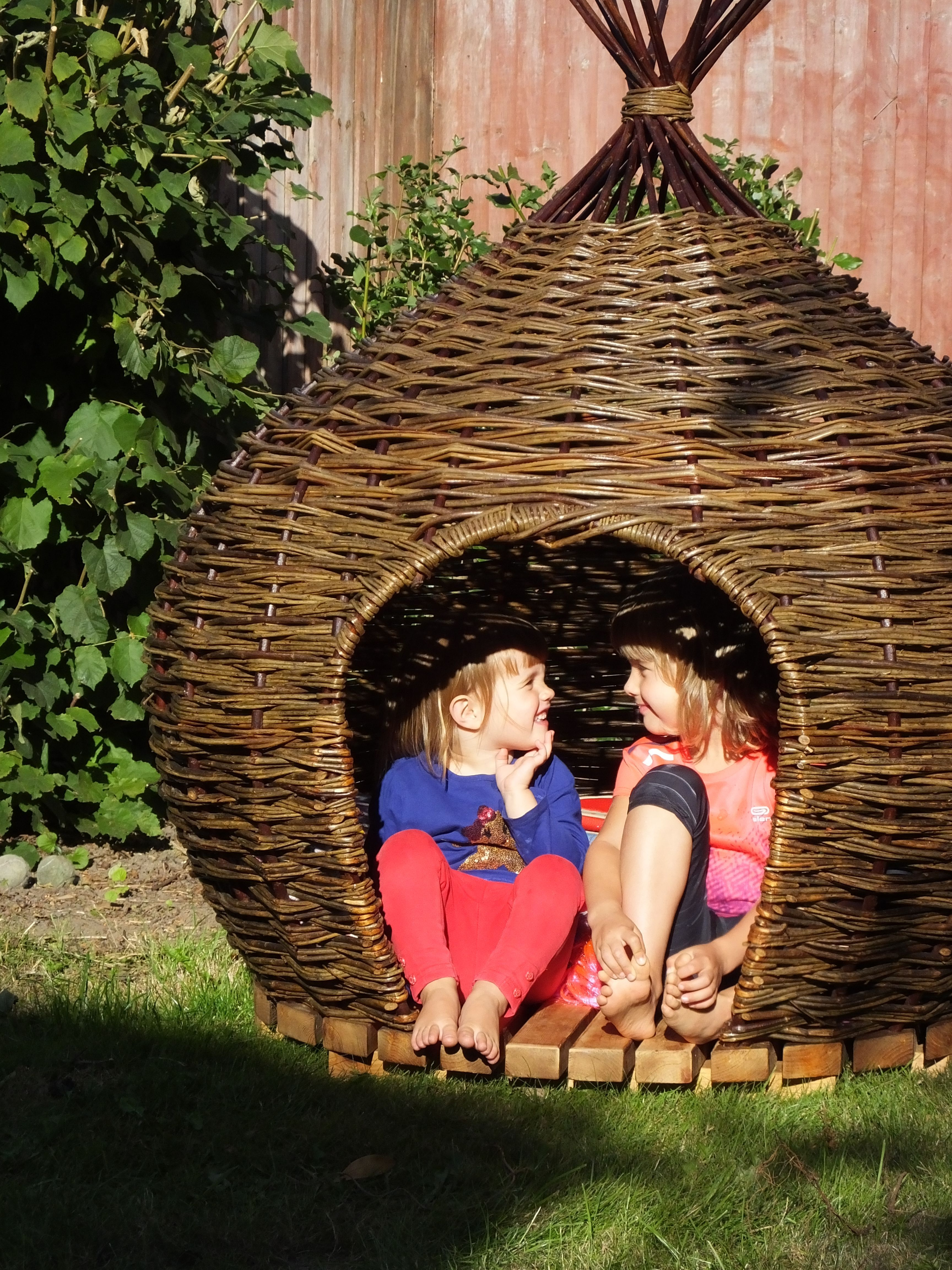 An onionshaped woven willow playhouse by Judith Needham