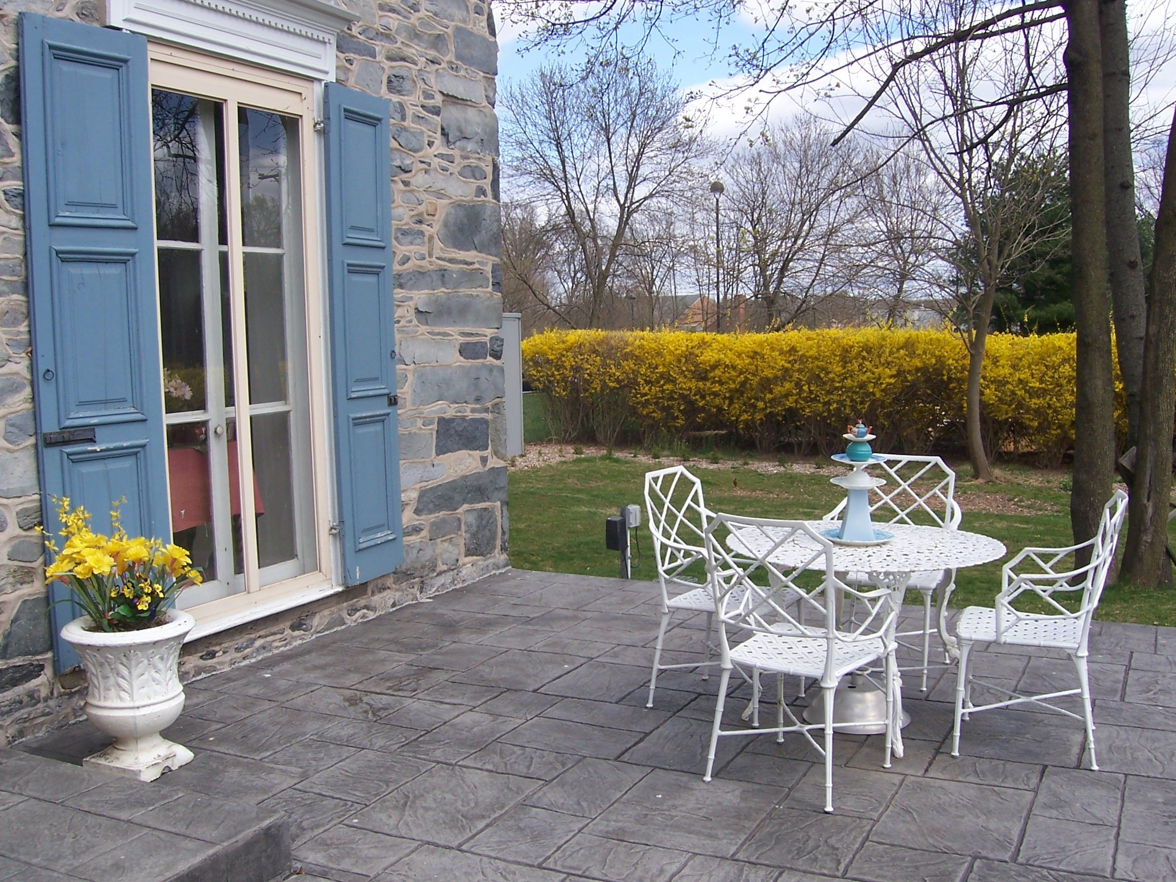 A patio to relax with coffee and homemade cake OR wine and