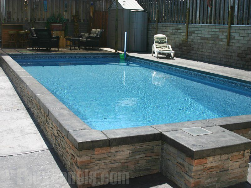 Faux stone veneer wraps this pool giving it a sophisticated ...